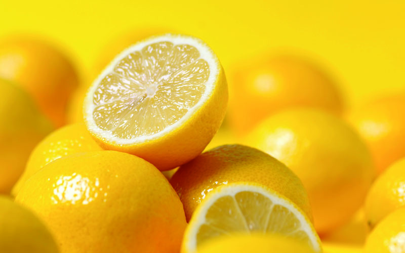 group of lemon on yellow background